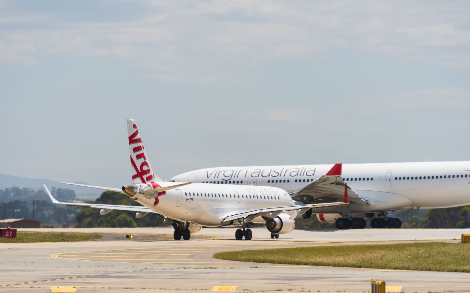 Newlywed asked to pay more than $8,000 for Virgin Australia flight after changing last name