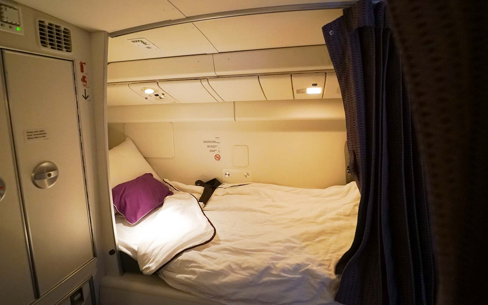 The Secret Plane Compartments Where Pilots Nap on Long Flights