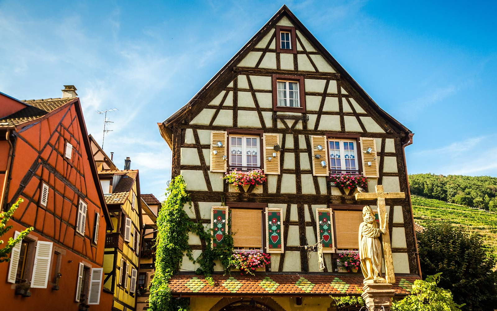 "Kaysersberg is a picturesque medieval village located on the ""Alsace Wine Route"". This building is one of the many beautiful and colourful half timbered houses of the village and it's located in Jean Ittel Square. The fountain is named after emperor Const"