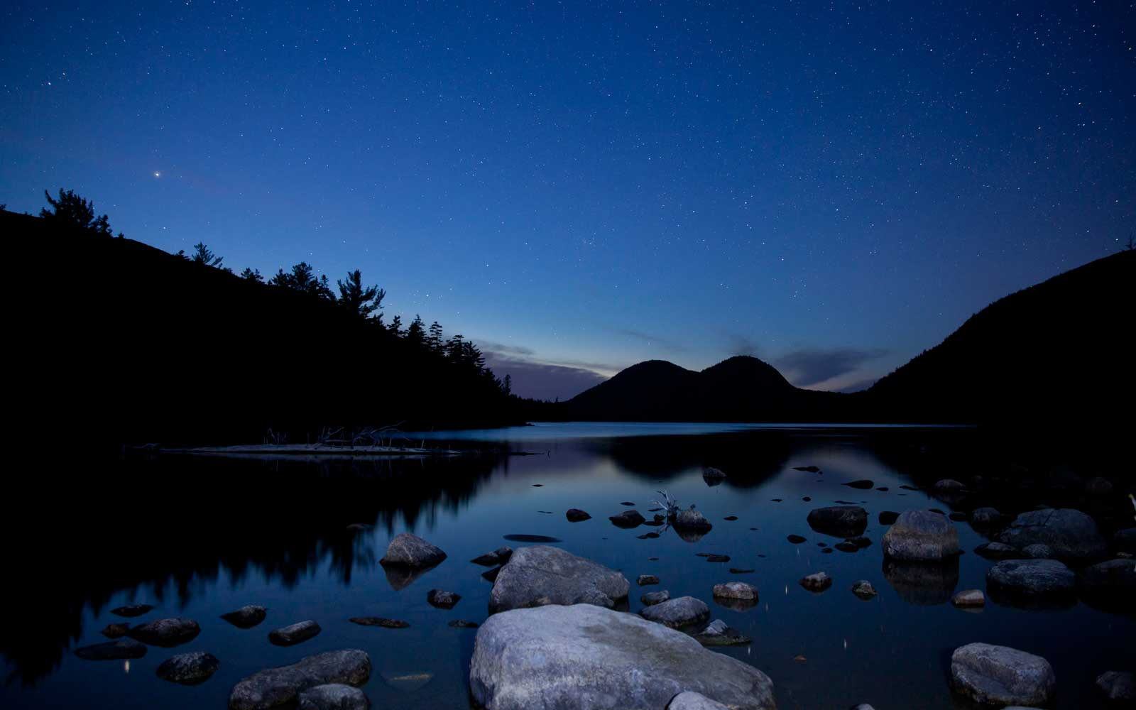 Jordan pond in Acadia National Park with night stars.