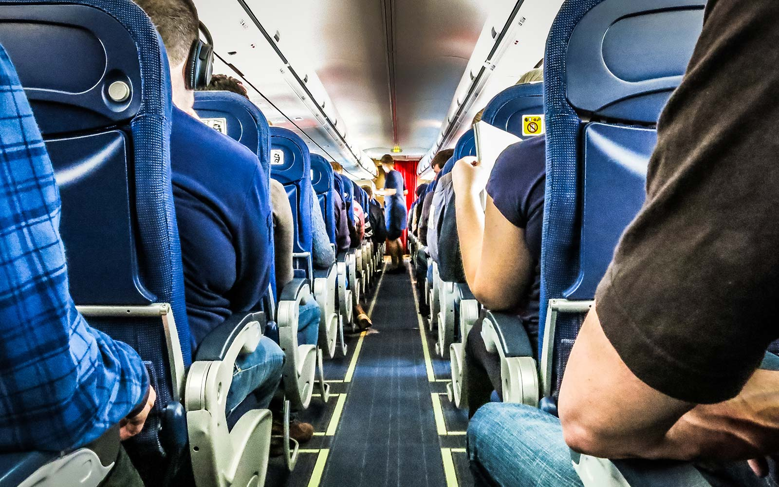 Flying With a Group? Here's How to Make Sure You Sit Together