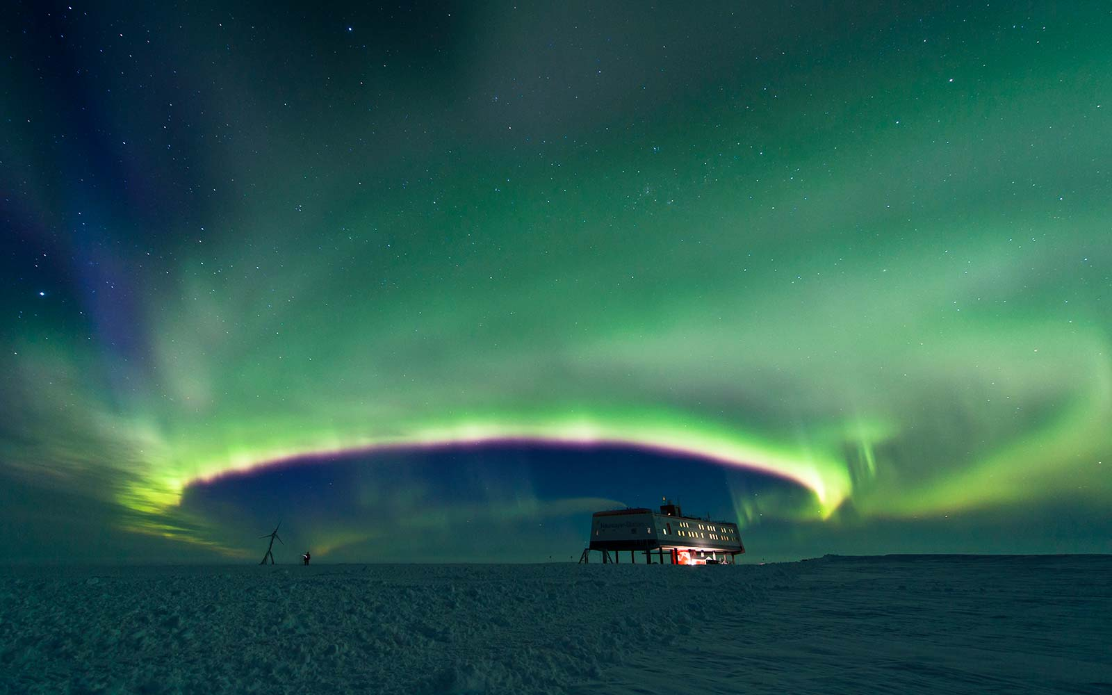 The Aurora Australis displaying over German Antarctic Research Base Neumayer III. It takes an almost perfectly round shape, a sight which is very rare.