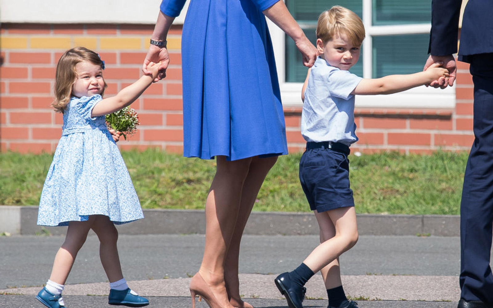 BERLIN, GERMANY - JULY 19:  Prince George of Cambridge and Princess Charlotte of Cambridge arrive at Berlin military airport during an official visit to Poland and Germany on July 19, 2017 in Berlin, Germany.  (Photo by Samir Hussein/WireImage)