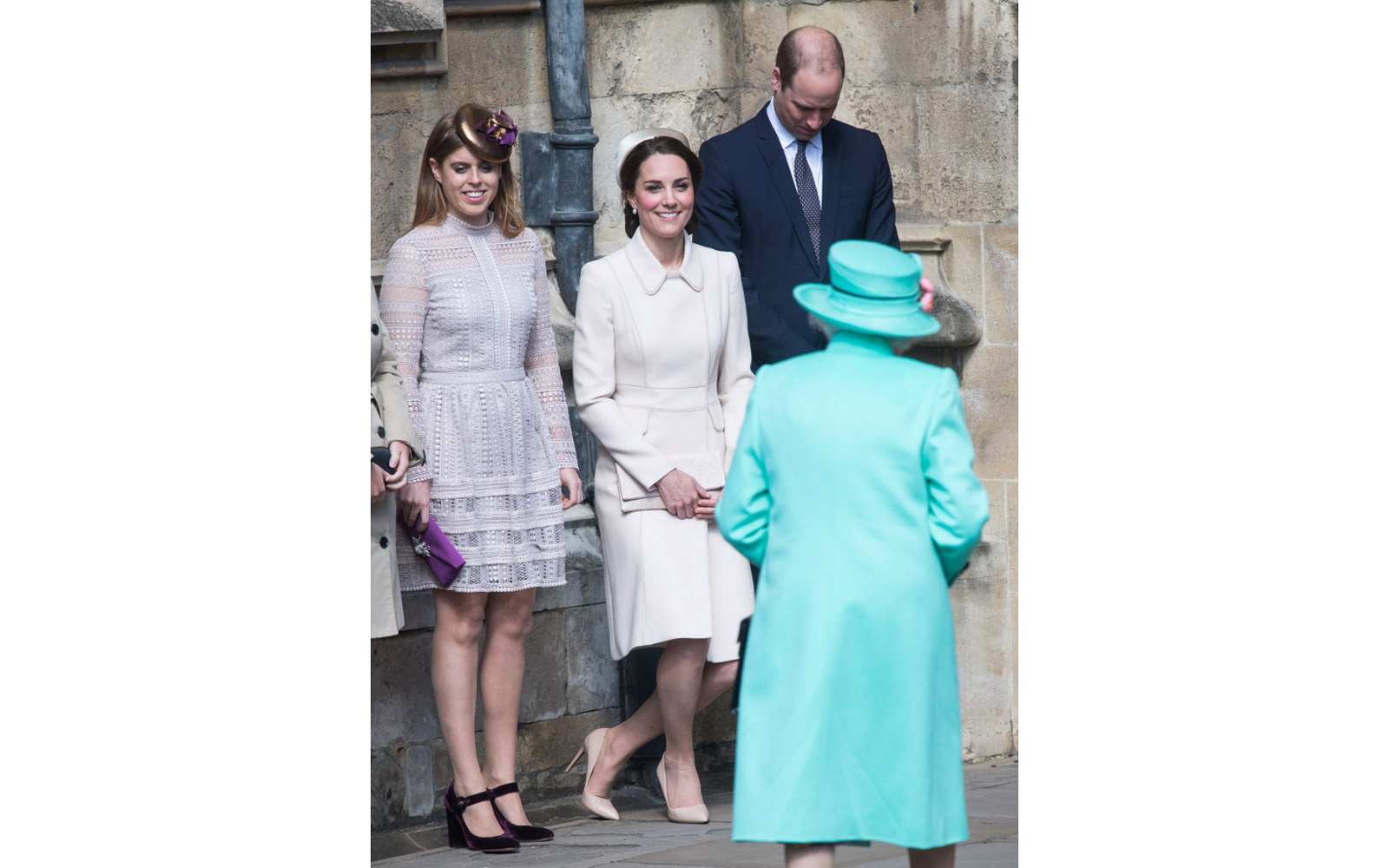 WINDSOR, ENGLAND - APRIL 16:  Catherine, Duchess of Cambridge performs a curtsy to Queen Elizabeth II as she attends Easter Day Service with Prince William, Duke of Cambridge and Princess Beatrice of York at St George's Chapel on April 16, 2017 in Windsor