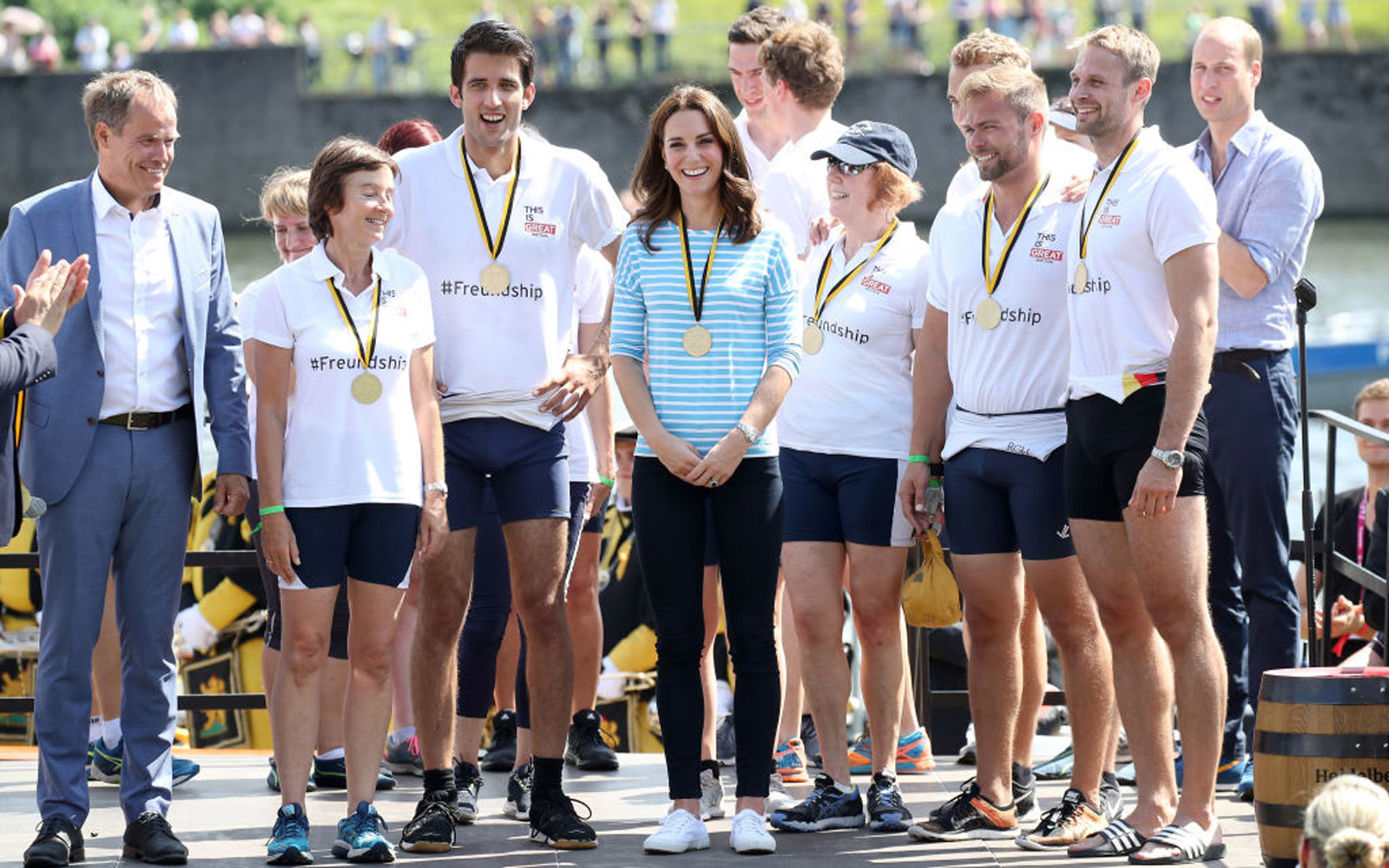 HEIDELBERG, GERMANY - JULY 20:  Catherine, Duchess of Cambridge and her team with their medals after participating in a rowing race between the twinned town of Cambridge and Heidelberg and against Prince William, Duke of Cambridge on day 2 of their offici