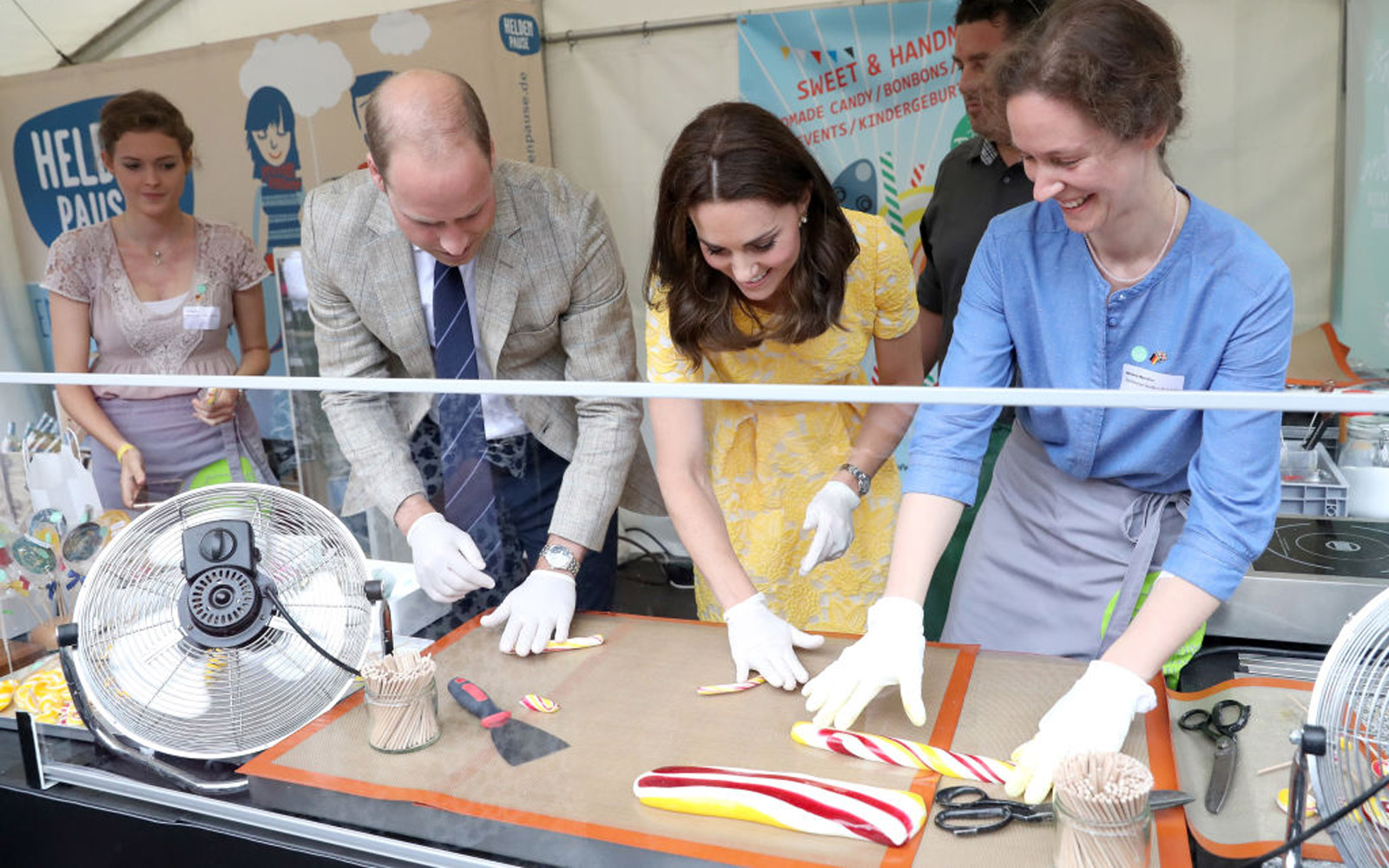 HEIDELBERG, GERMANY - JULY 20:  Prince William, Duke of Cambridge and Catherine, Duchess of Cambridge attempt to make sweets during a tour of a traditional German market in the Central Square on day 2 of their official visit to Germany on July 20, 2017 in