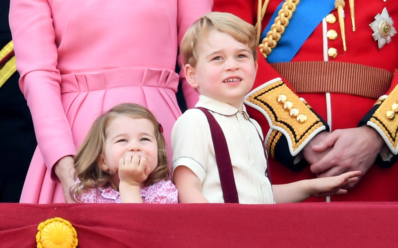 Princess Charlotte of Cambridge and Prince George of Cambridge look on from the balcony during the annual Trooping The Colour parade at the Mall in London, England