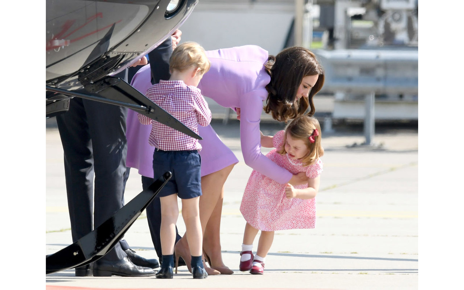 HAMBURG, GERMANY - JULY 21:  Prince George, Princess Charlotte of Cambridge and Catherine, Duchess of Cambridge view helicopter models H145 and H135 before departing from Hamburg airport on the last day of their official visit to Poland and Germany on Jul