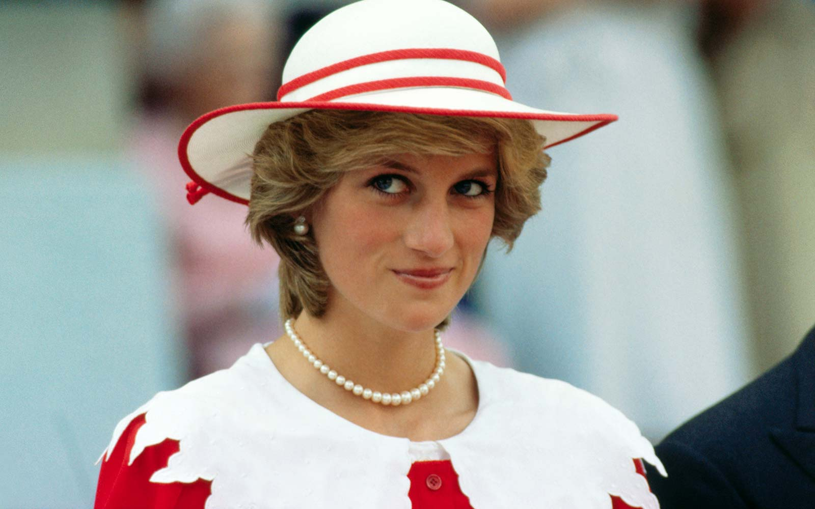 Diana, Princess of Wales, wears an outfit in the colors of Canada during a state visit to Edmonton, Alberta