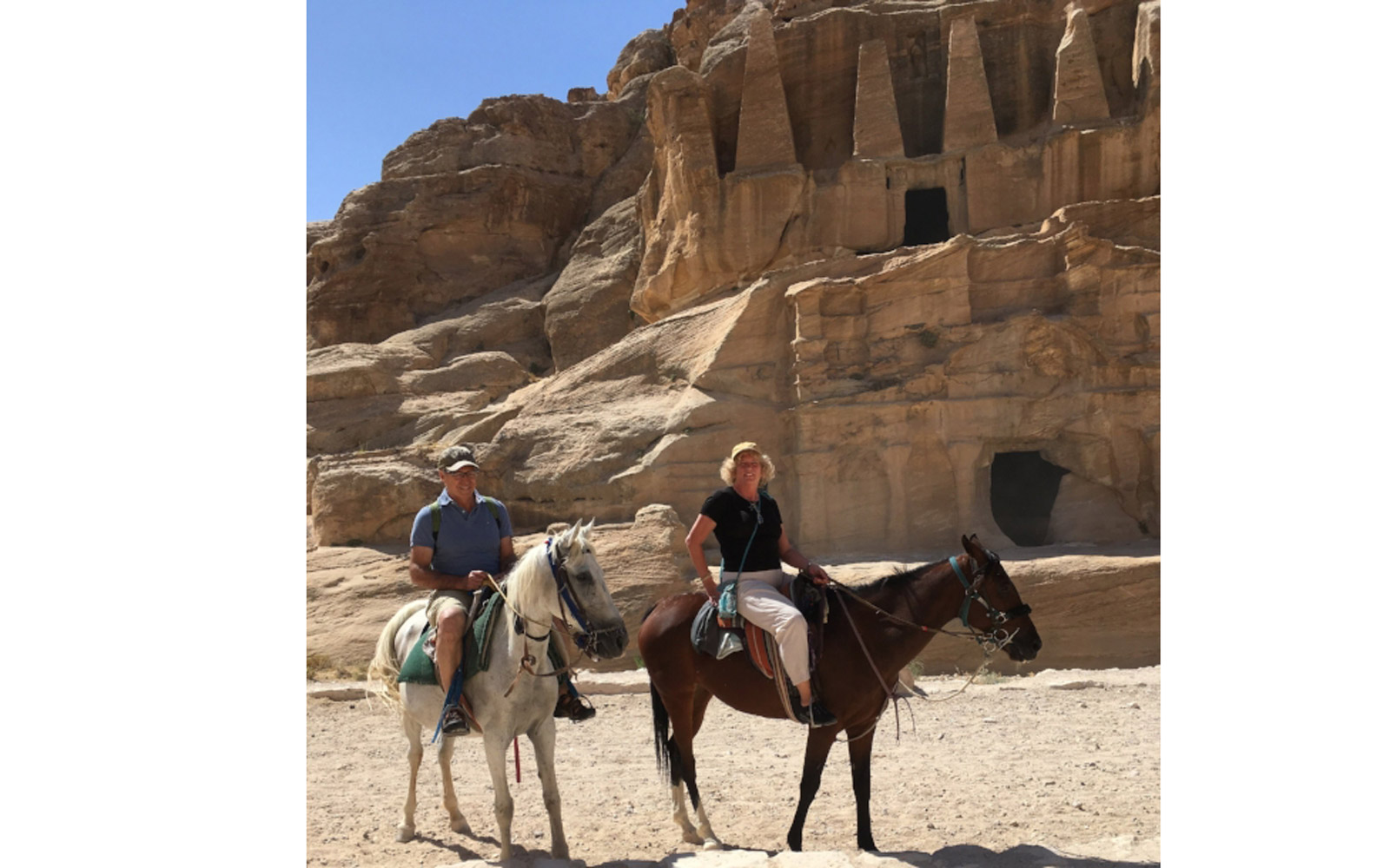 Michael and Debbie Campbell traveling by camel