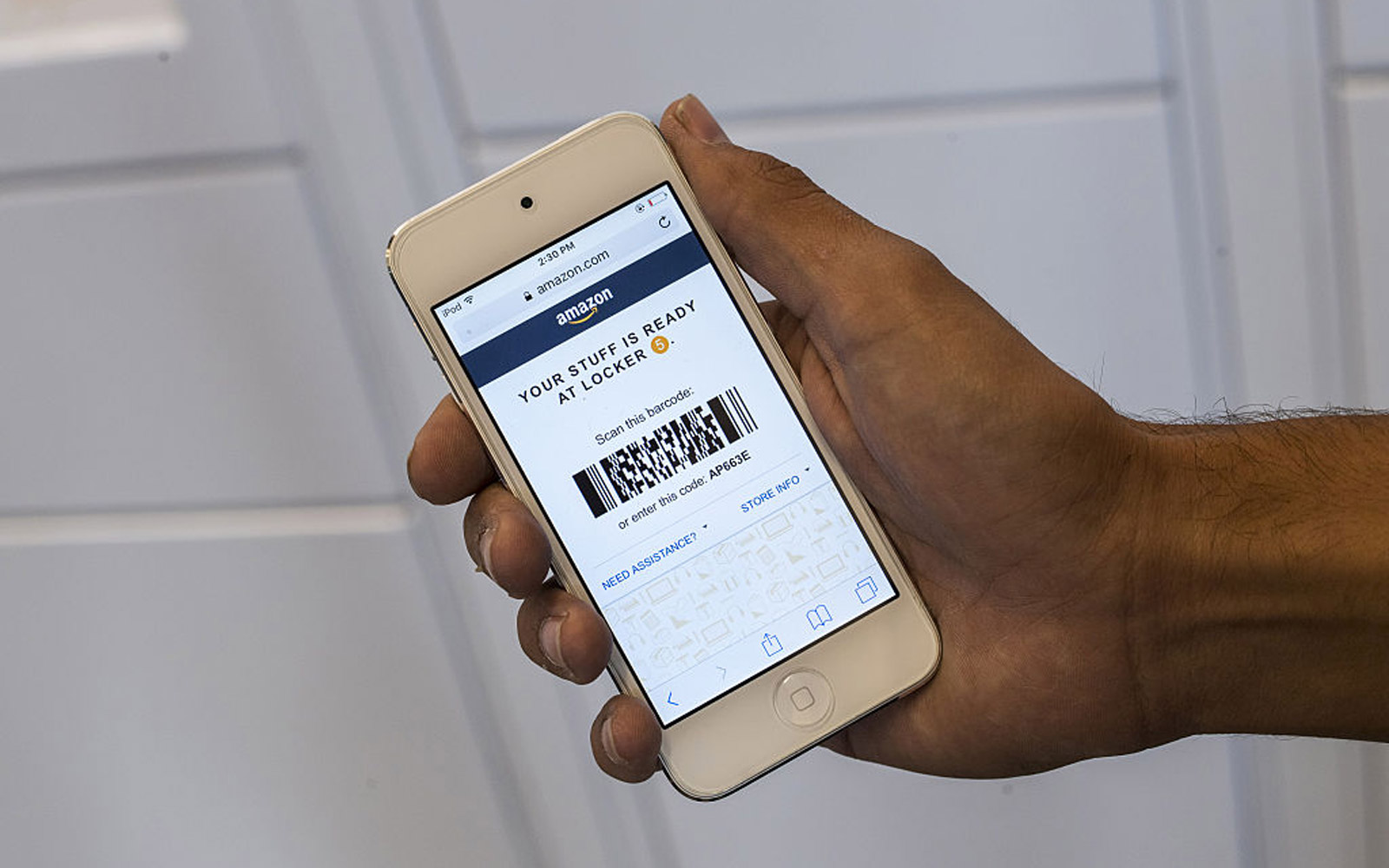 An Amazon.com Inc. webpage is displayed on an Apple Inc. iPhone for a photograph at an Amazon.com Inc. kiosk on the University of California, Berkeley campus in Berkeley, California, U.S., on Wednesday, Oct. 12, 2016. By the end of the year, Amazon will h