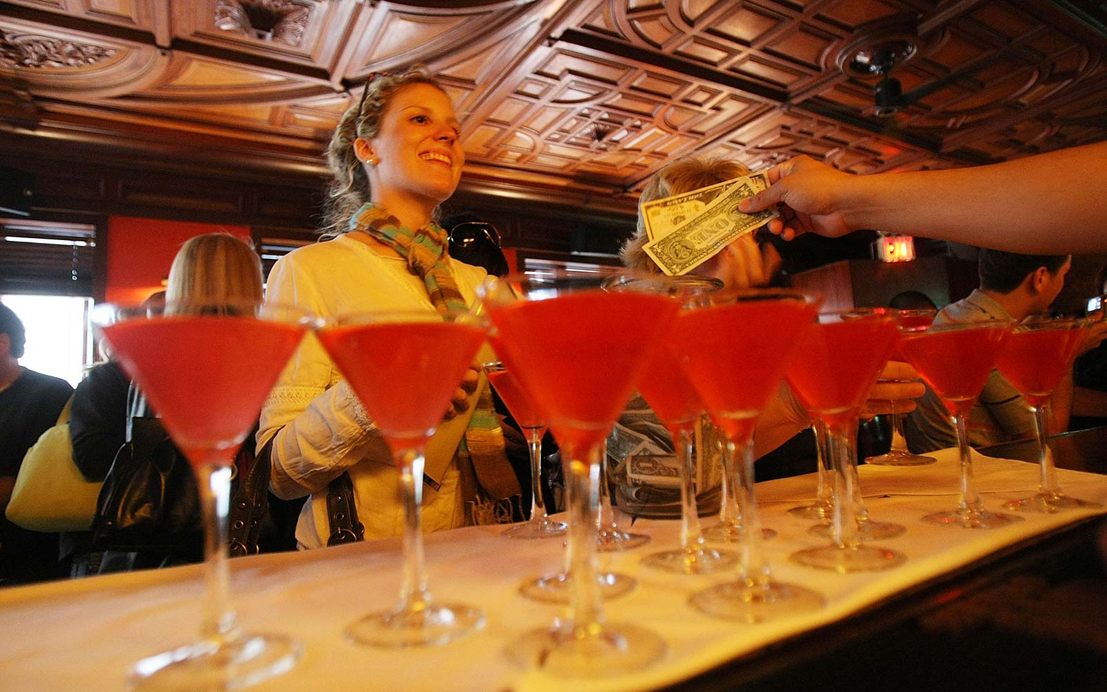 A participant buys a Cosmopolitan cocktail at Onieal's Grand Street bar during a 'Sex and the City' tour in New York City. The tour visits over 40 locations from the TV series