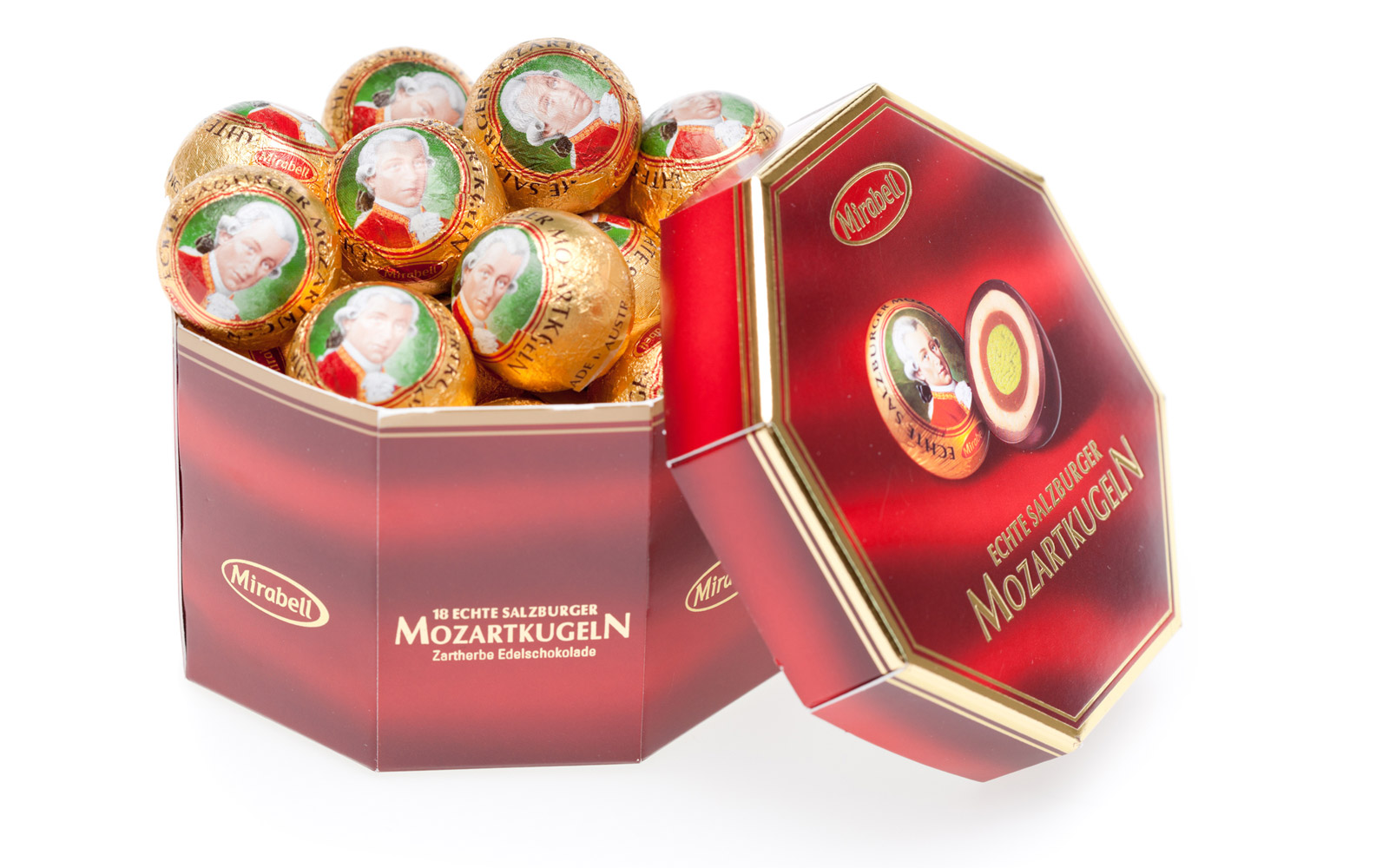 "Voesendorf, Austria - March, 29 2011: studio shoot of many ""salzburger mozartkugeln"" in box isolated on white, typical austrian sweet present"