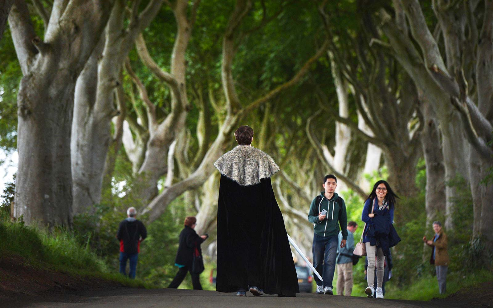 Game of Thrones tourists take photographs of one another as they visit a beech tree lined road known locally as The Dark Hedges in Belfast, Northern Ireland Winterfell Festival National Trust