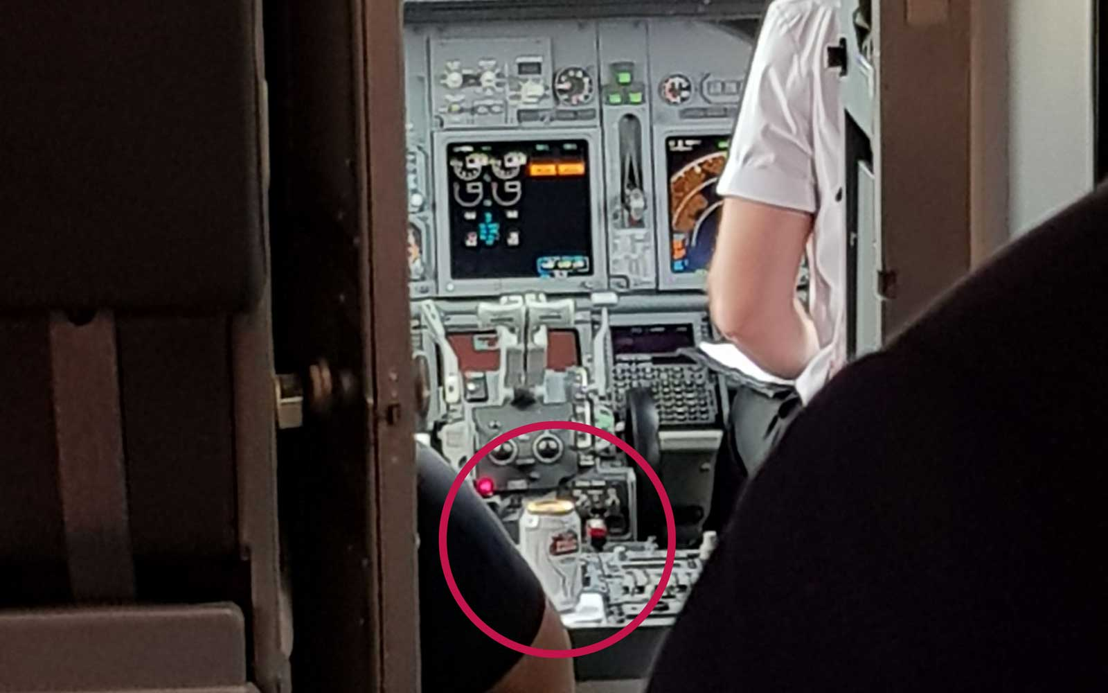 Passenger Spots a Beer Next to Pilot in Airplane's Cockpit