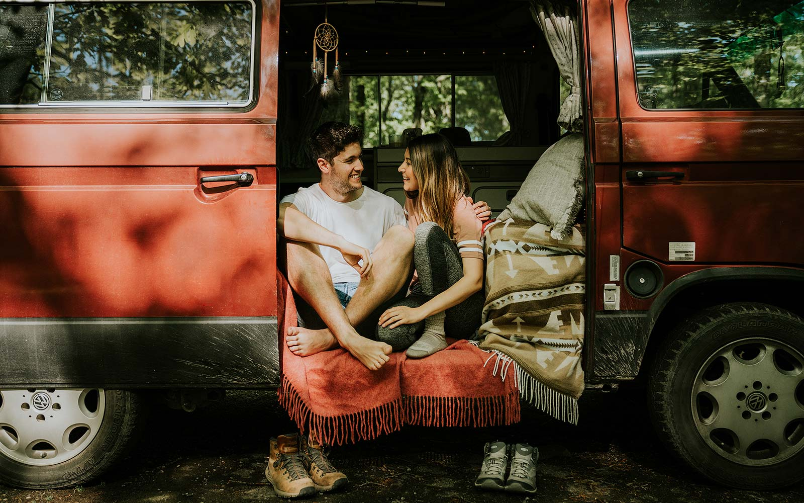 Meet the Couple Traveling to 59 National Parks in Their Tiny Red Van