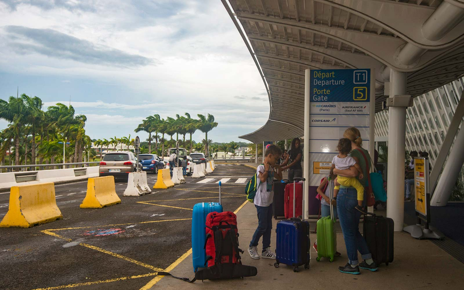 Passengers arrive to board their plane at the departures terminal at the Pole Caraibes international airport in Pointe-a-Pitre, which re-opened on September 6, 2017, after hurricane Irma hit the island.Hurricane Irma, one of the most powerful Atlantic st