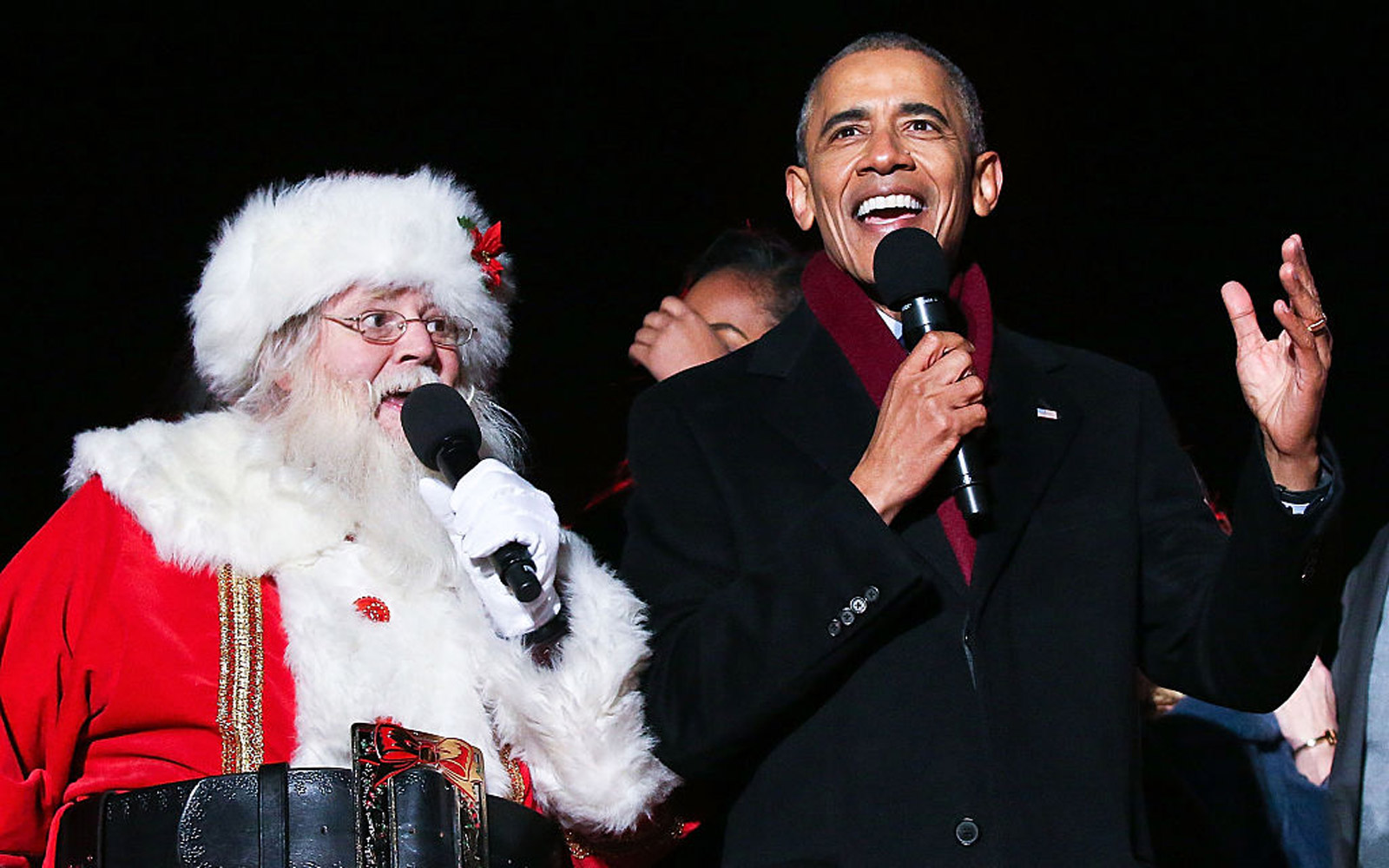 """WASHINGTON, DC - DECEMBER 01:  President Barack Obama sings """"Jingle Bells"""" with Santa Claus during the 94th Annual National Christmas Tree Lighting Ceremony on the Ellipse in PresidentÕs Park on December 1, 2016 in Washington, DC.  (Photo by Paul Morigi/"""