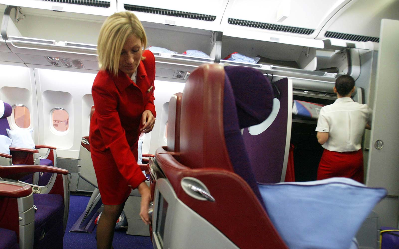 Virgin Atlantic airplane cabin flight attendant