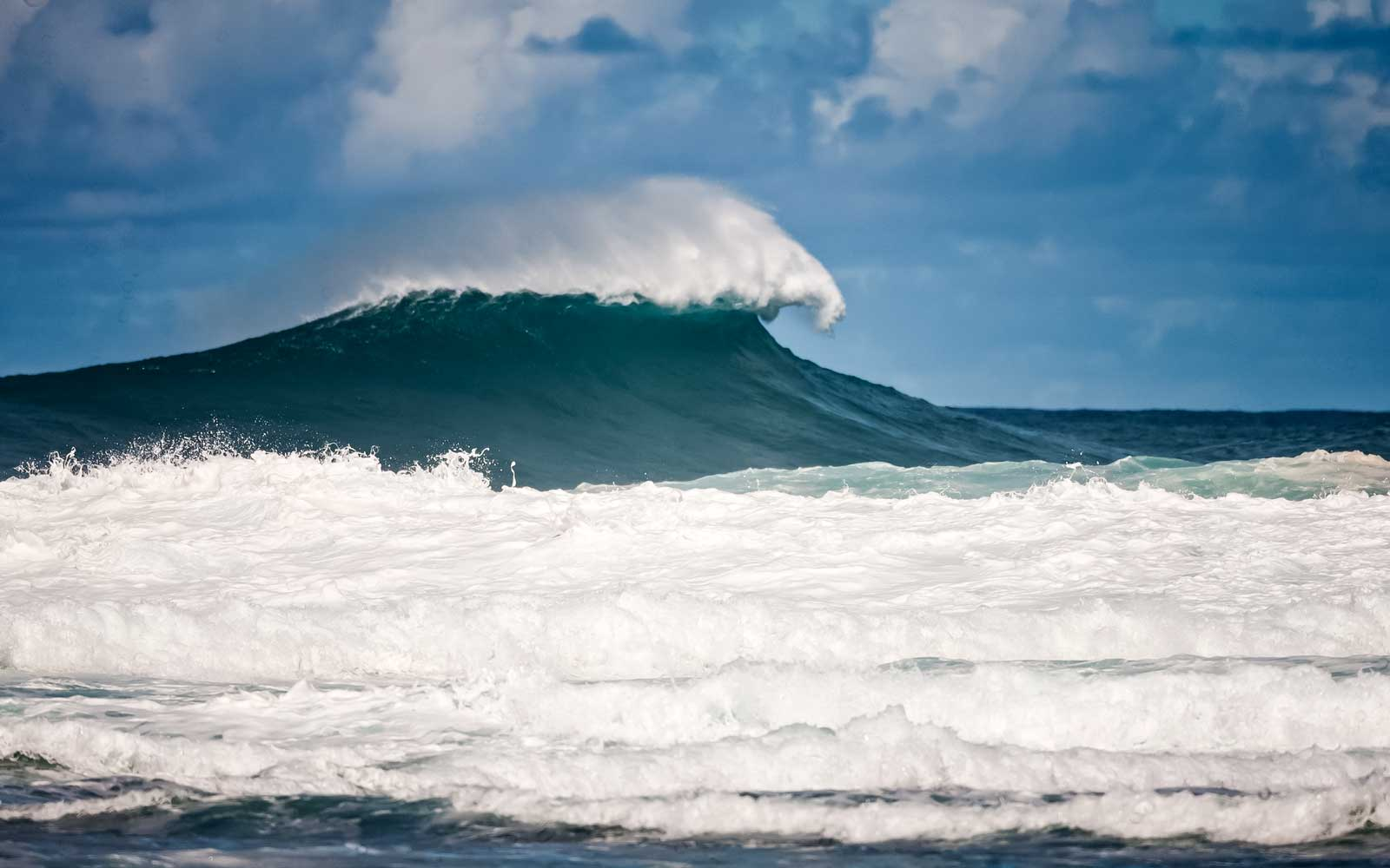 Wave breaking off the shore in Kappa, Hawaii