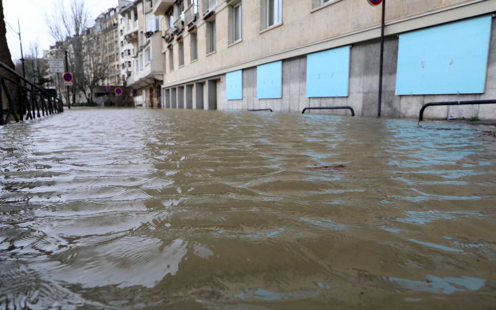 flooded pavement after the River Seine burst its banks in Paris on January 24, 2018