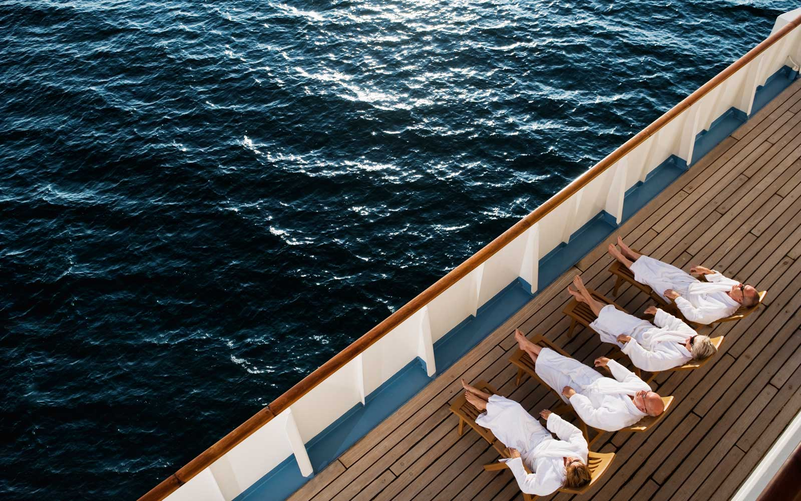 Four friends relaxing on a cruise ship deck