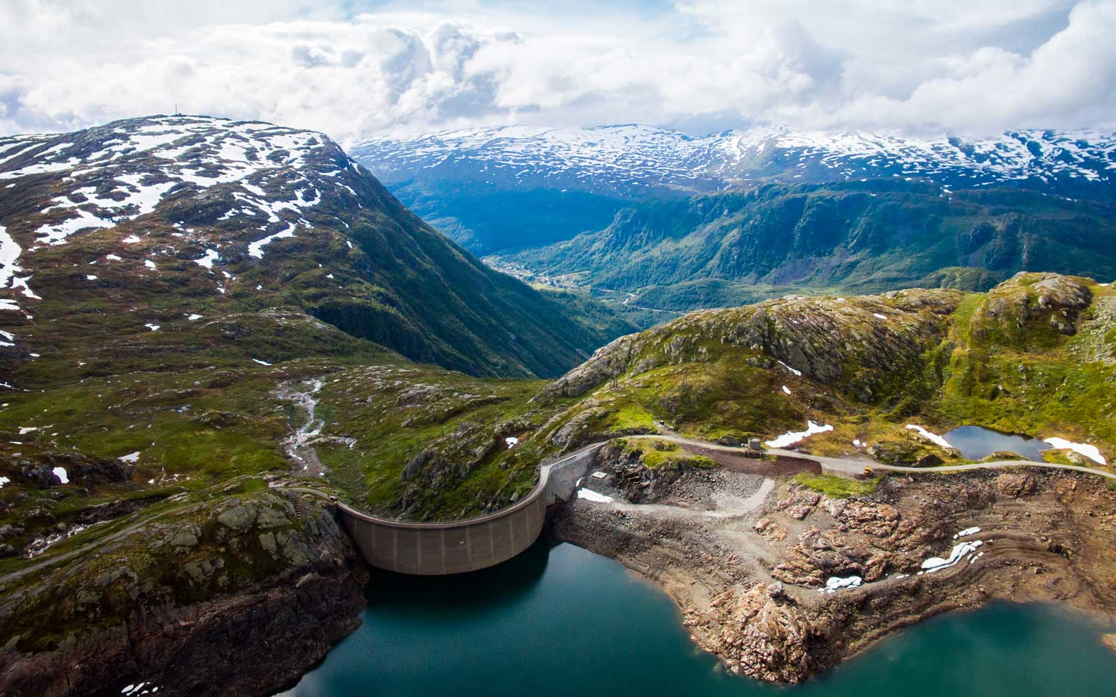 Votna's dam photographed from a high angle view. Votna is a lake in Odda, Norway