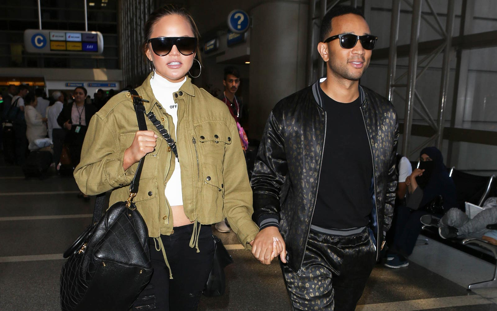 Why Chrissy Teigen and John Legend Still Fly Commercial