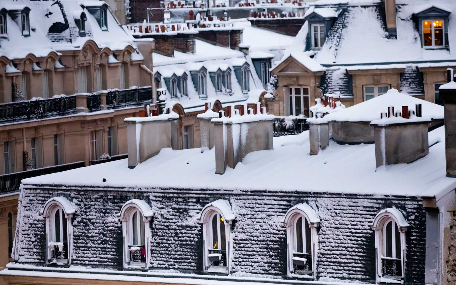 Traditional Paris rooftops covered in snow, February 2018