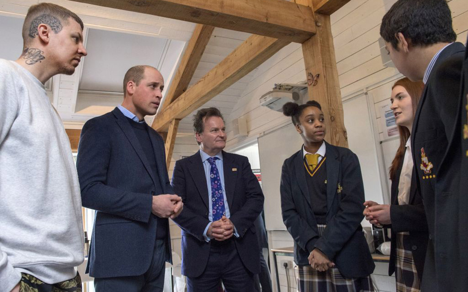 Britain's Prince William, Duke of Cambridge, accompanied by rapper Stephen Manderson aka Professor Green