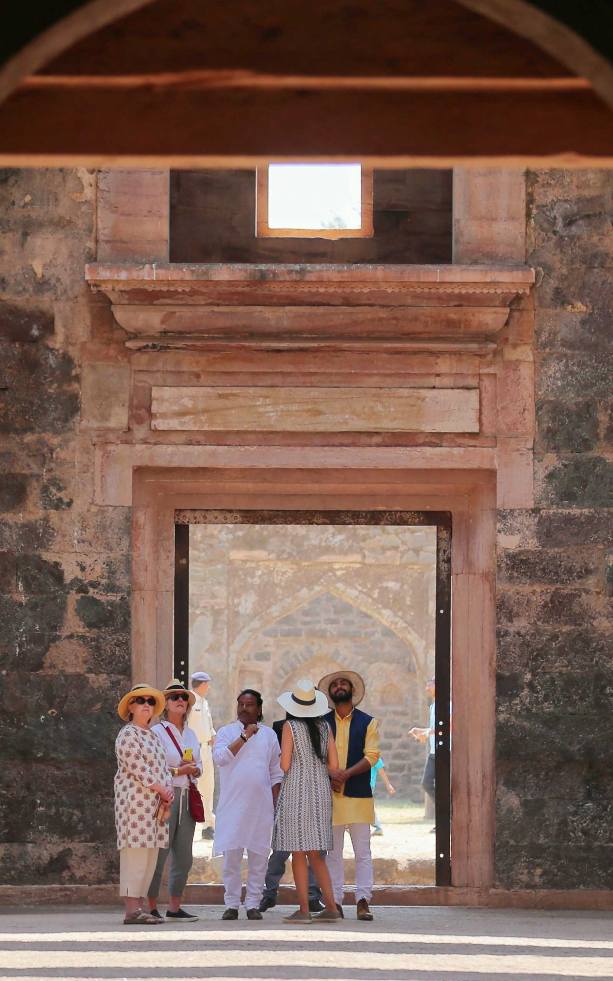 Hillary Clinton visits the remains of the Hindola Mahal monument, part of an abandoned royal palace complex, while on a personal trip to the ancient city of Mandu in India's Madhya Pradesh state on March 12, 2018.