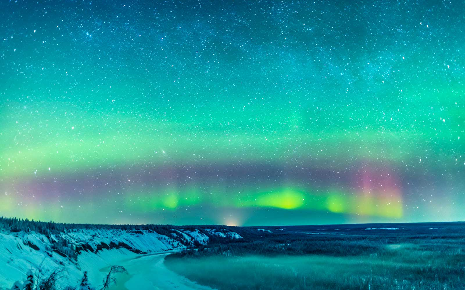 Green and red northern lights over the Copper River near Glennallen, Southcentral Alaska