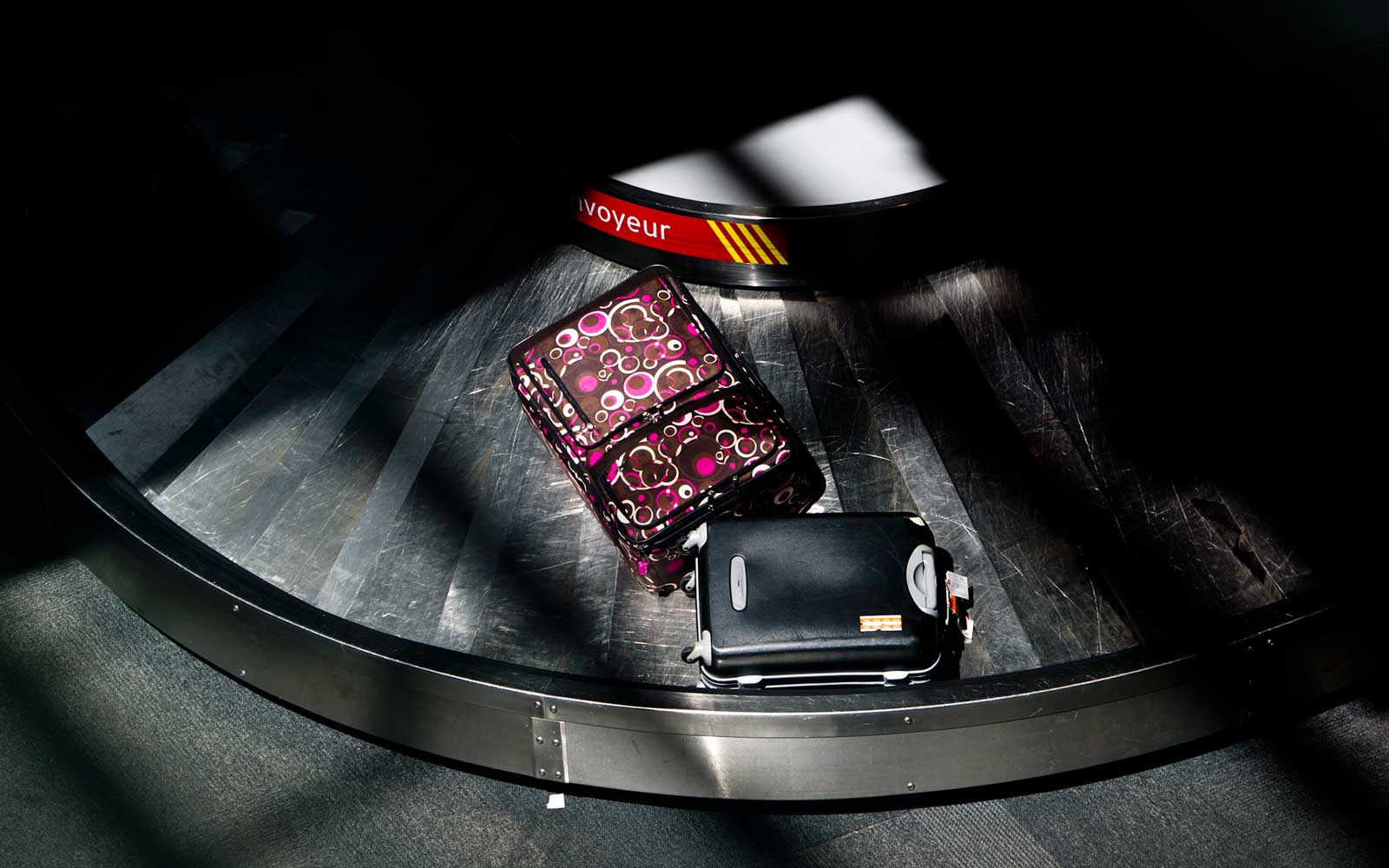 Luggage moves on a baggage carousel