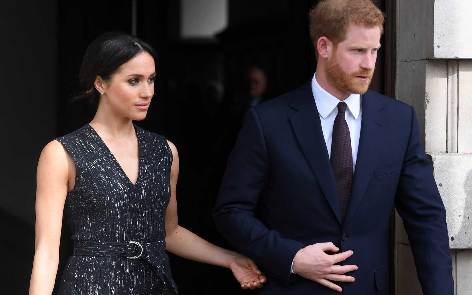 Britain's Prince Harry (R) and his US fiancee Meghan Markle