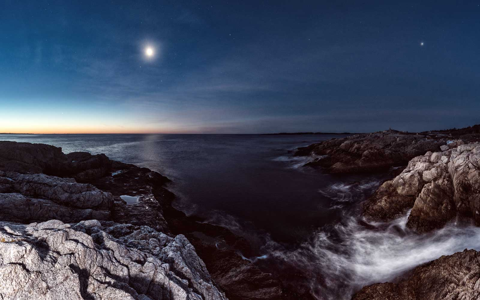 Mercury, Venus, Saturn, Mars, Jupiter, our Moon and Earth together in pre-dawn light overlooking a rugged stretch of Nova Scotian coastline.