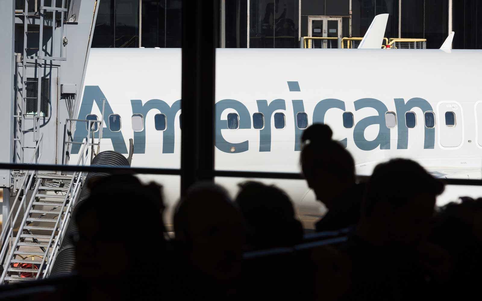 American Airlines plane parked at a gate