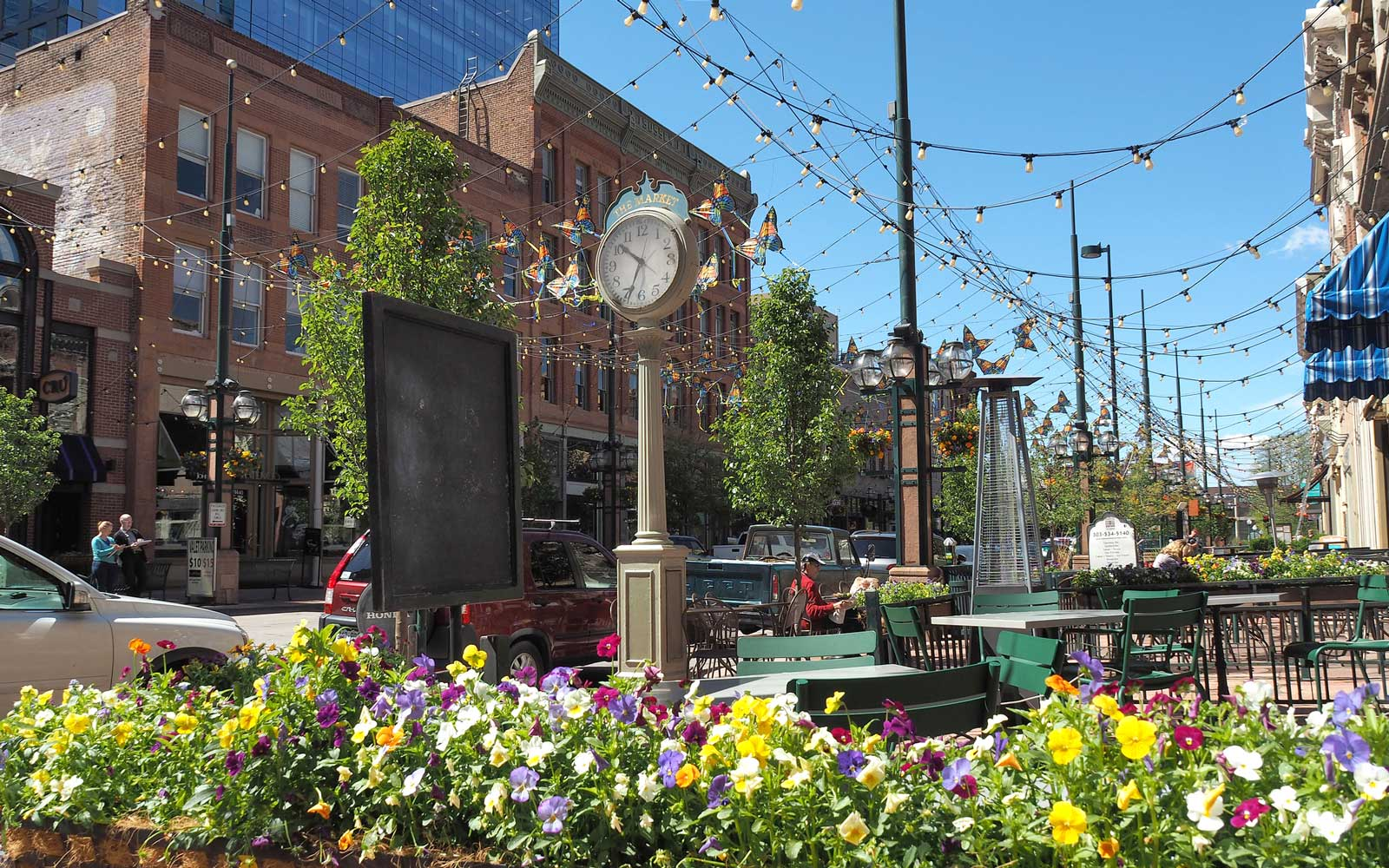 Sidewalk Café and Colorful Flowers In Larimer Street, Denver, Colorado