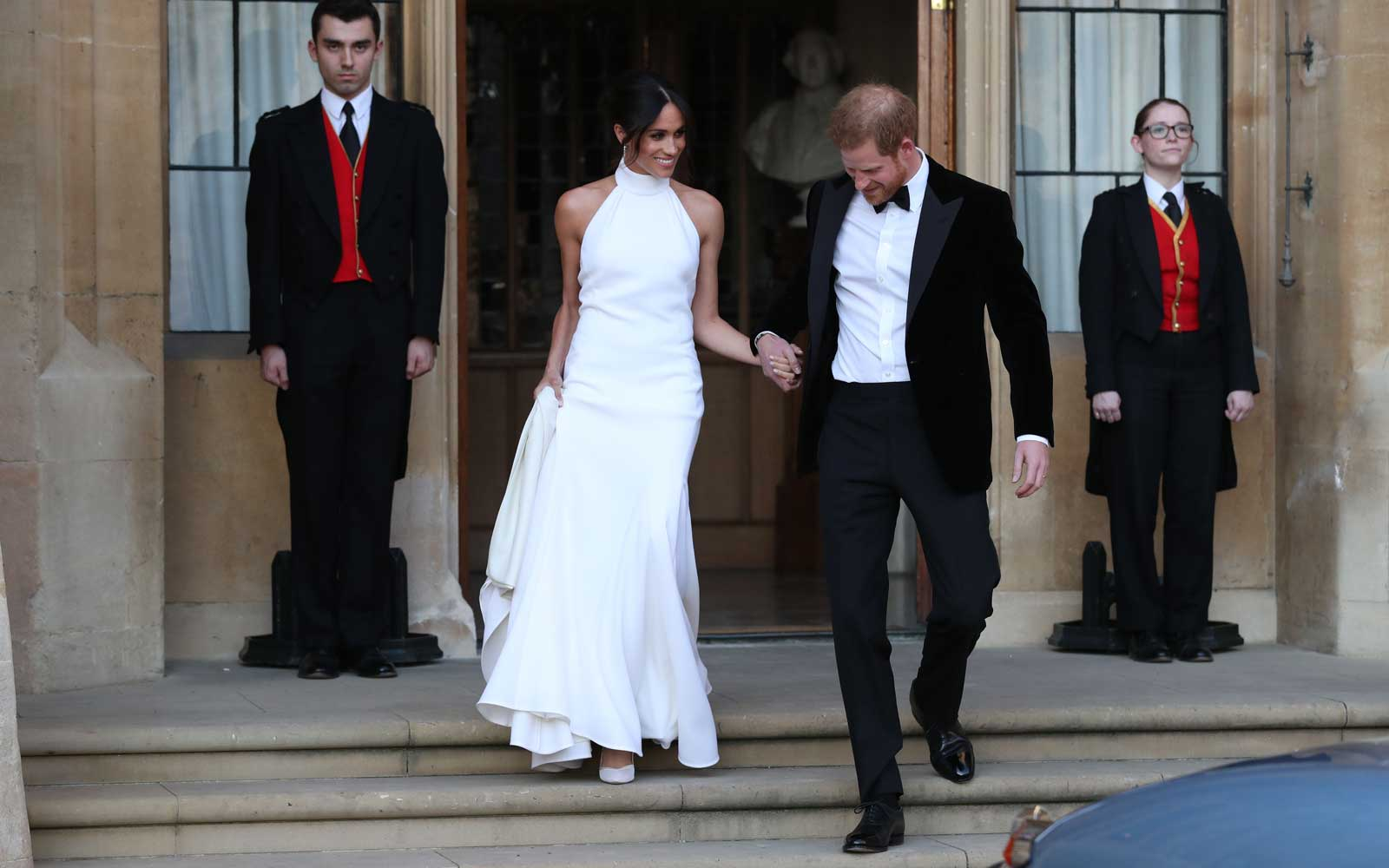 Newly married Britain's Prince Harry, Duke of Sussex and Meghan Markle, Duchess of Sussex, leave Windsor Castle in Windsor