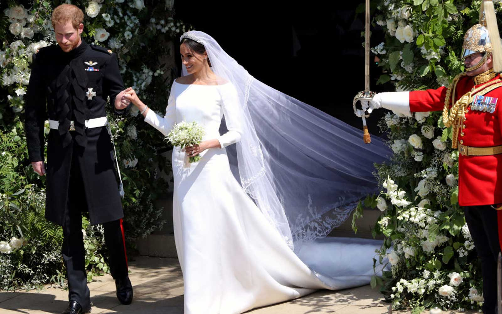 Britain's Prince Harry, Duke of Sussex and his wife Meghan, Duchess of Sussex emerge from the West Door of St George's Chapel, Windsor Castle, in Windsor, on May 19, 2018 after their wedding ceremony.
