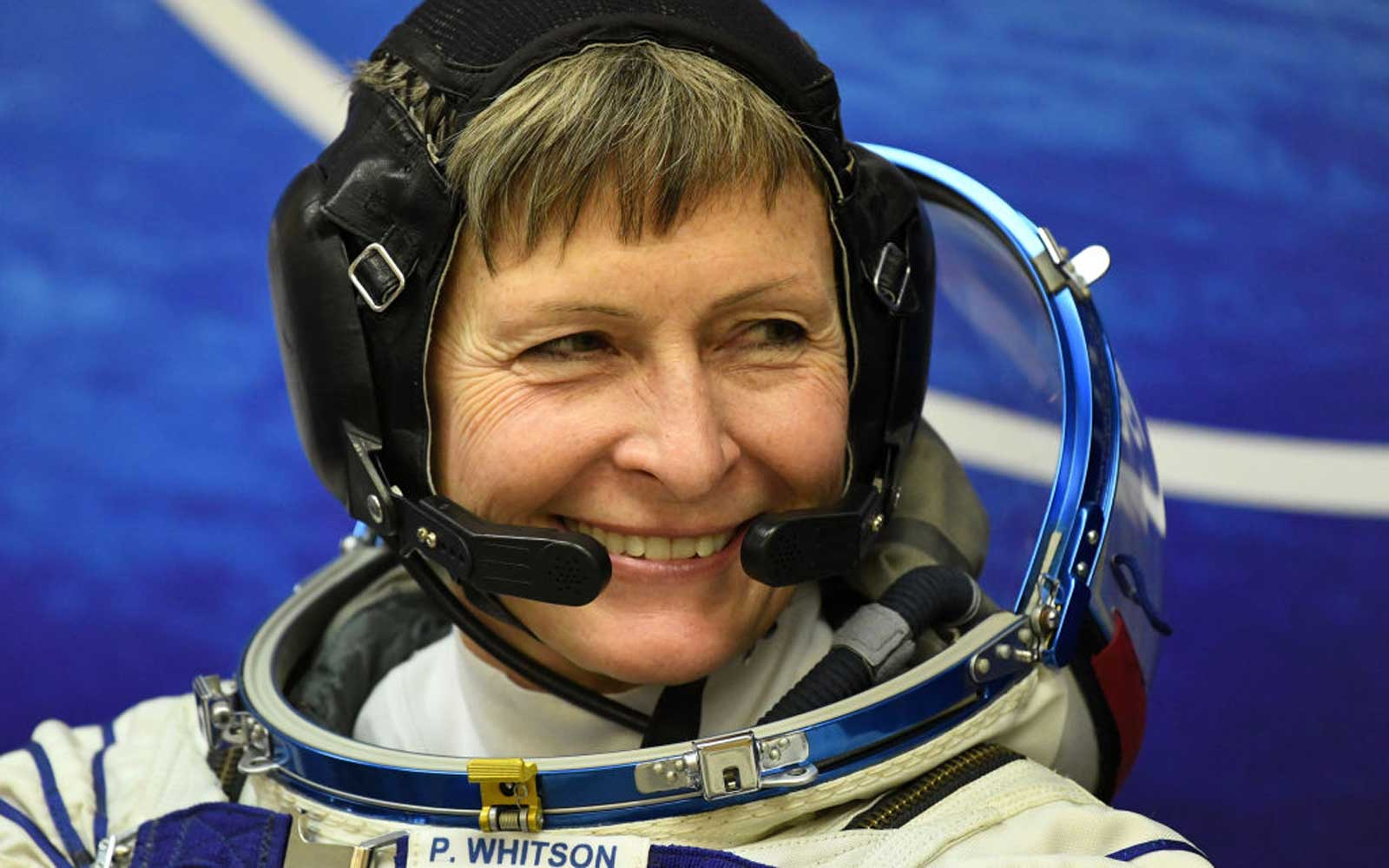 US astronaut Peggy Whitson looks on in her space suit at the Russian-leased Baikonur cosmodrome in Baikonur