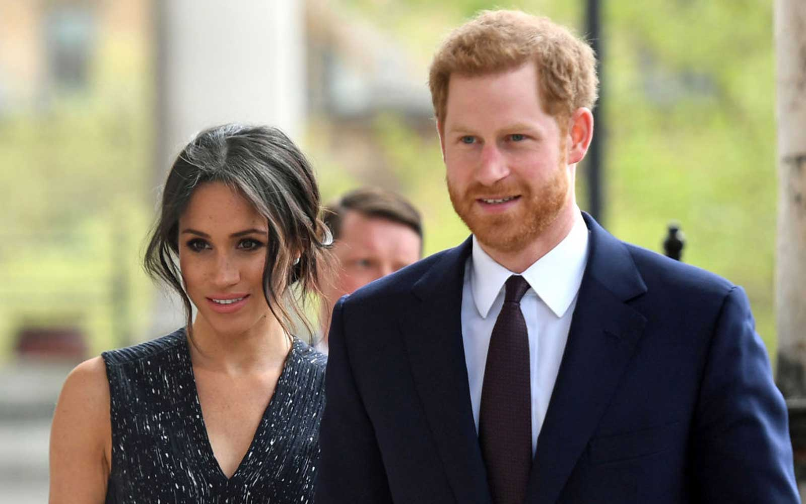 Britain's Prince Harry (R) and his US fiancee Meghan Markle arrive to attend a memorial service at St Martin-in-the-Fields in Trafalgar Square in London