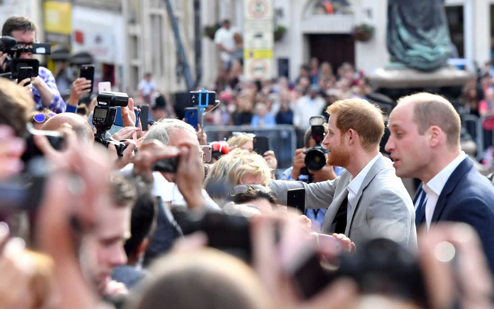 Prince Harry And Prince William Meet The Public During A Pre Wedding Walkabout In Windsor