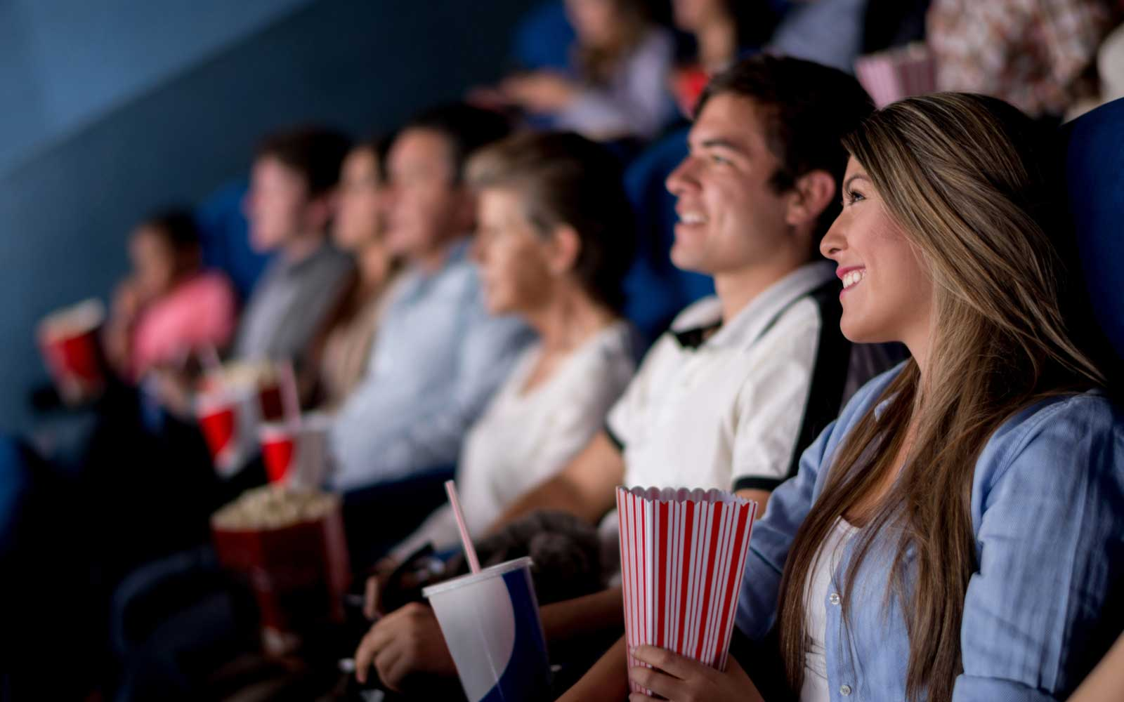 Group of people at the cinema looking happy
