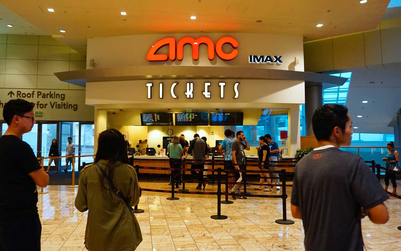 Movie goers purchase tickets at an AMC movie theater in Arcadia, California