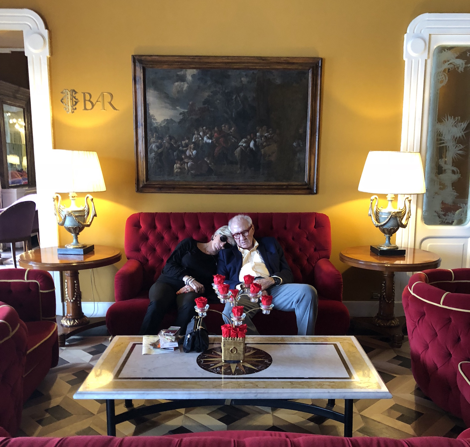 A couple takes a nap in the lobby of Grand Hotel Tremezzo