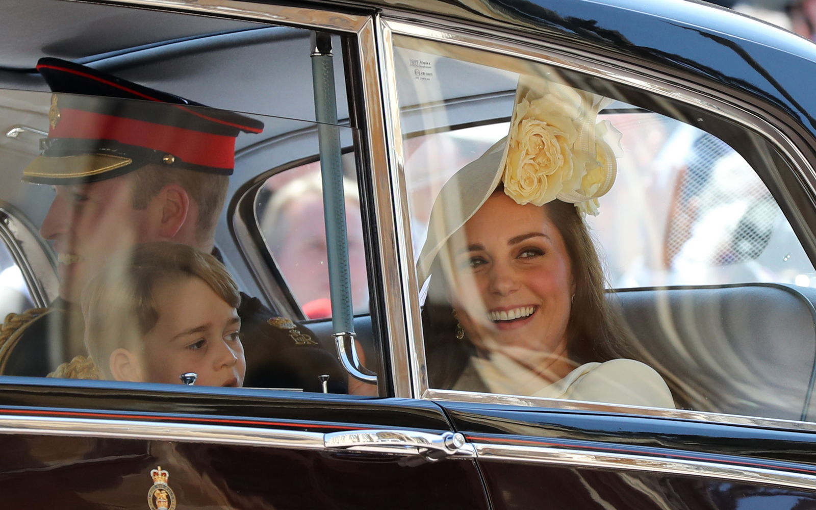Prince William and Catherine Duchess of Cambridge in car with son, Prince George