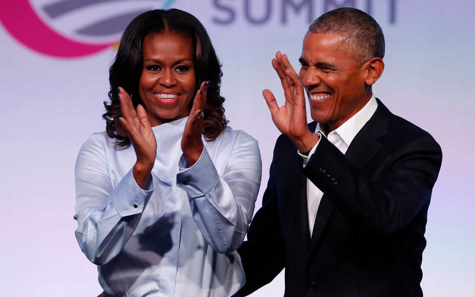 Former US President Barack Obama and his wife Michelle arrive at the Obama Foundation Summit