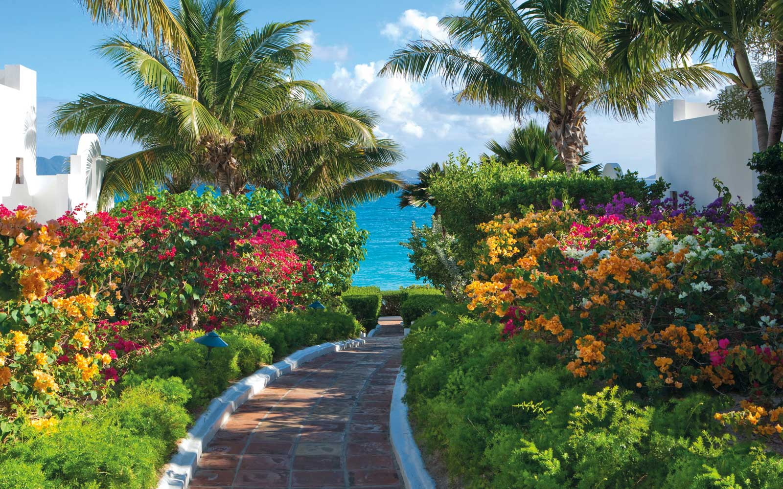 Flower lined path at the Belmond Cap Juluca resort in Anguilla
