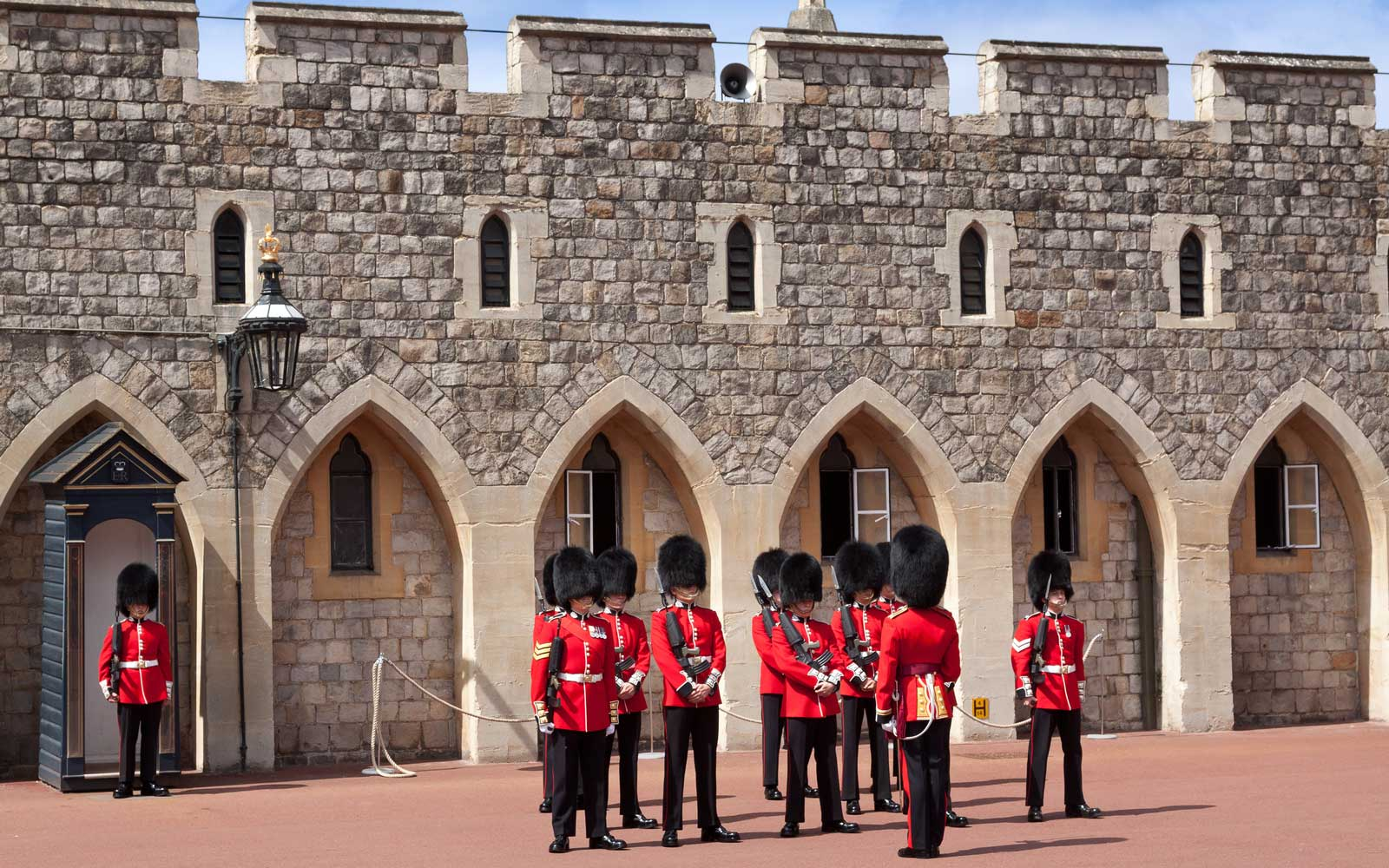 Watch a Member of the Queen's Guard Push a Tourist After She Got in the Way