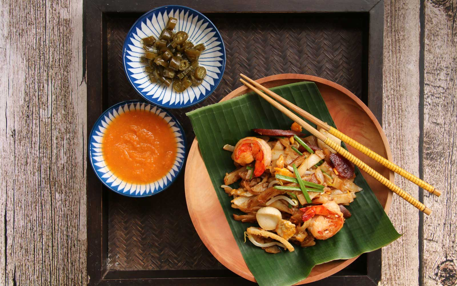 Char Kway Teow on Wooden Plate